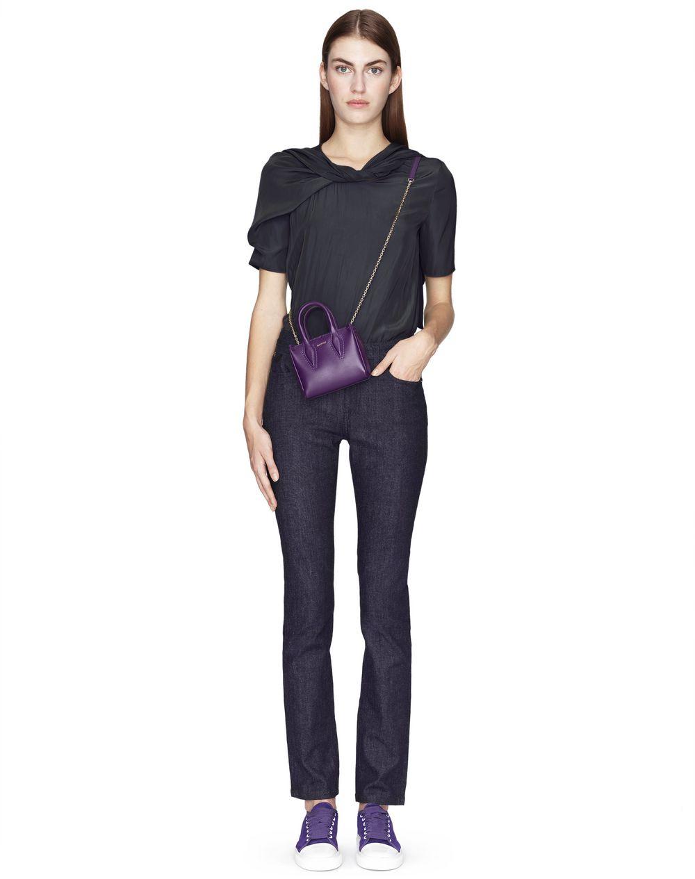 Pantalon en denim de coton tissé couleur indigo Lanvin – Prix €490