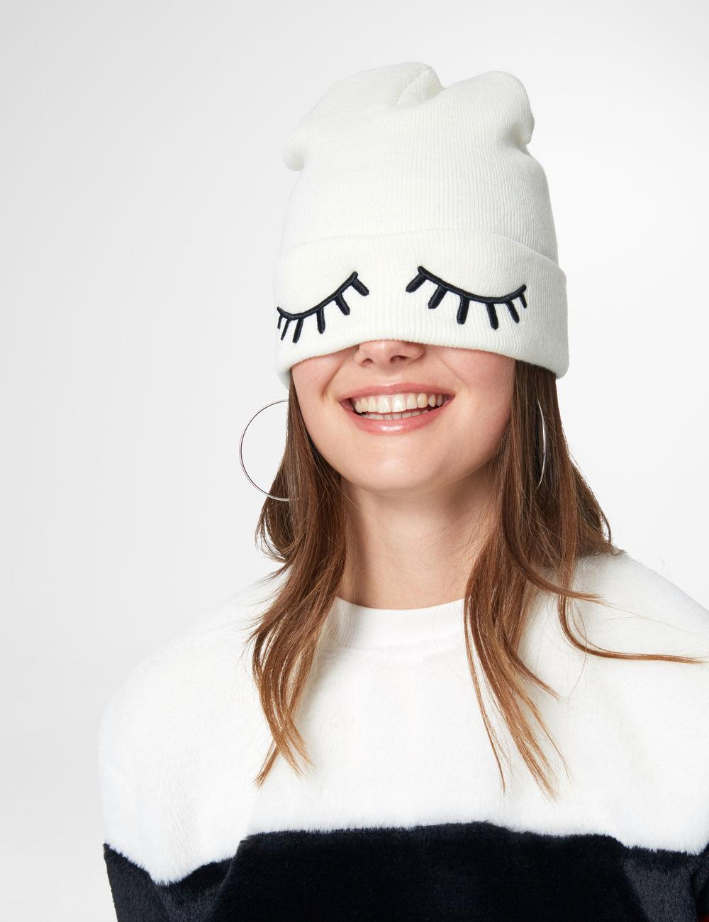 bonnet avec yeux écru Jennyfer prix 7,99 €